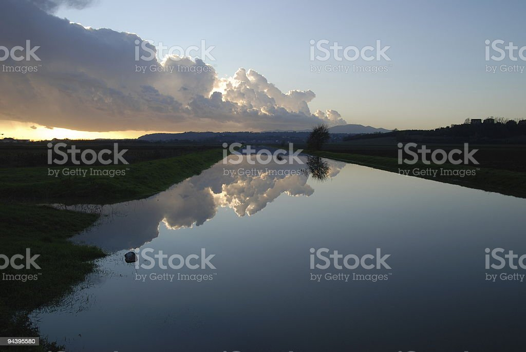 River reflection at sunset after the storm stock photo