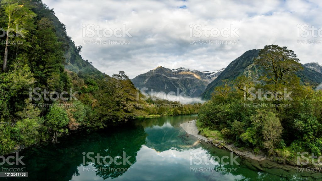 River Reflection River and mountains in New Zealand. Adventure Stock Photo