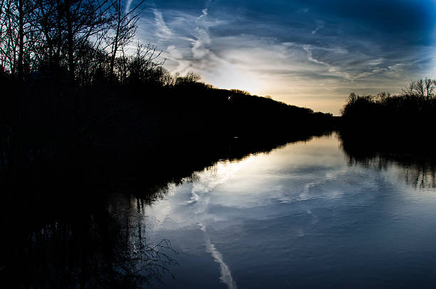 River reflection Sunset on the Huron River. Ann Arbor, MI ann arbor stock pictures, royalty-free photos & images