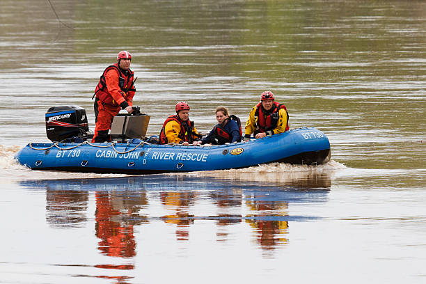 river rescue, kayaker rescued and brought back to shore - livbåt bildbanksfoton och bilder