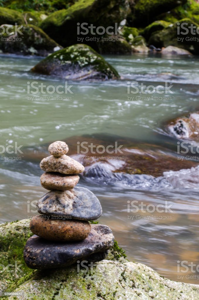 River rock tower stock photo