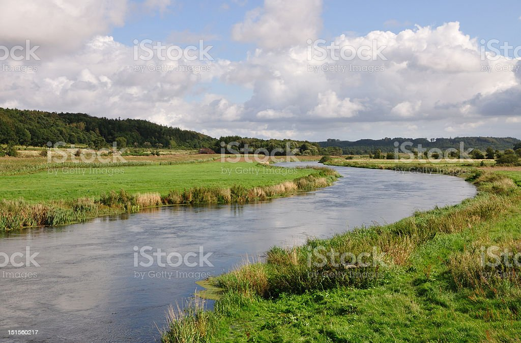 River running through a valley stock photo