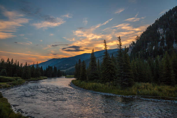 a river runs through it. - montana western usa stock pictures, royalty-free photos & images