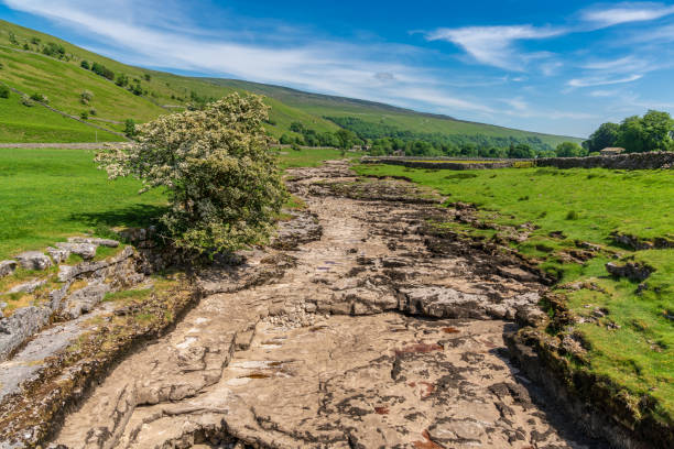 River Skirfare, near Litton, North Yorkshire, England, UK Yorkshire landscape with the dried-up River Skirfare near Litton, North Yorkshire, England, UK riverbed stock pictures, royalty-free photos & images