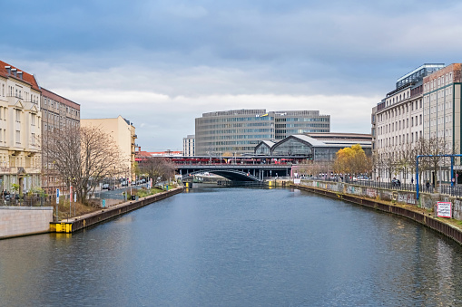 River Spree with the railway station Friedrichstrasse and an area Spreedreieck in Berlin, Germany
