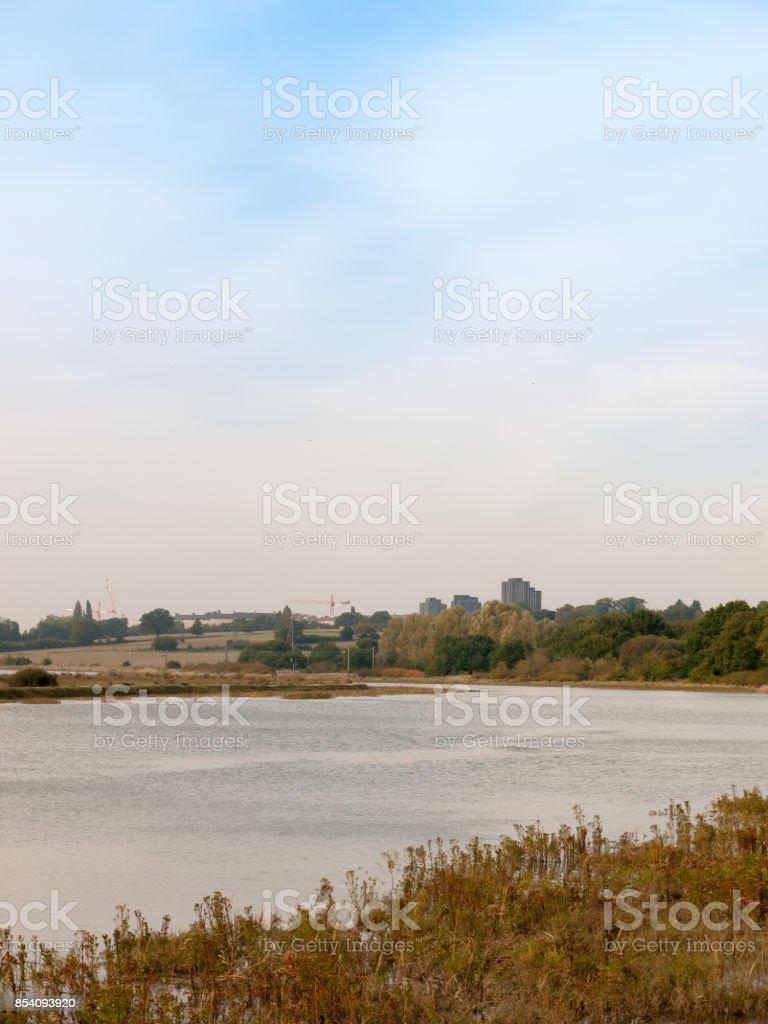 river stream scene autumn empty coast outside water sea essex university towers background stock photo