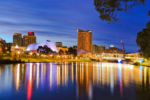 Capital of SOuth Australia - Adelaide city CBD at sunrise reflecting in still waters of torrens river