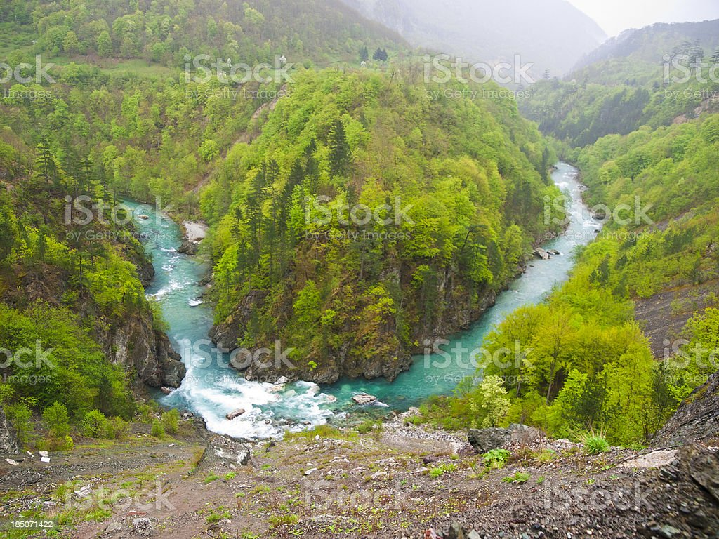 river surrounded by green hills stock photo