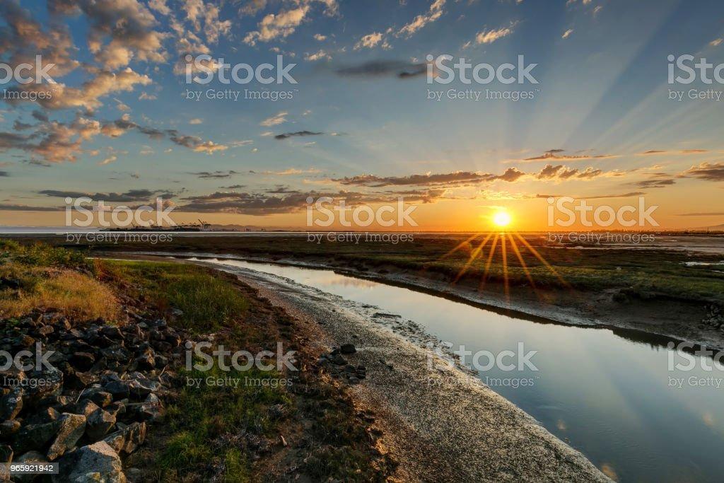 river to sea at sunset - Royalty-free BC Stock Photo