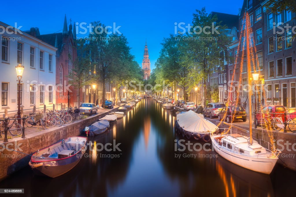 River, traditional old houses and boats, Amsterdam stock photo