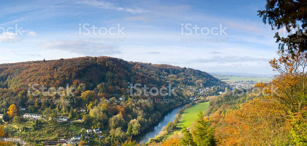 River valley village forest stock photo