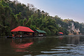 River view with raft house on River Kwai in KanchanaburiRiver view with raft house on River Kwai in Kanchanaburi