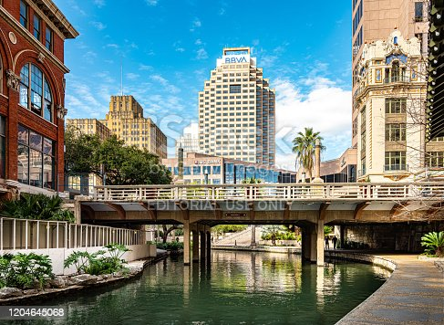 San Antonio, Texas, USA-January 31, 2020. Exterior of River Walk in downtown San Antonio. Project started in 1939 and was completed by the WPA in 1941. The goal was to transform the city area with way to battle floods. The canal water way provided San Antonio with green parks and two parallel sidewalks. The water depth of the Venice-like canal ranges from just two to four feet. Along the way, many tourist attractions: art work, museums, restaurants, hotels.