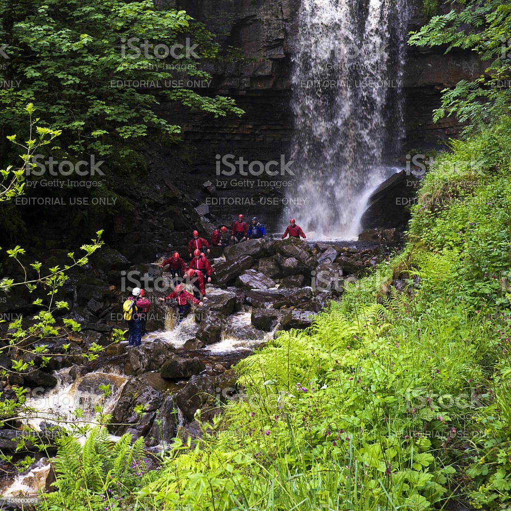River Walking Group at Ashgill Force Waterfall. stock photo