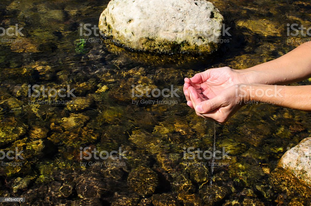 river water in my hands stock photo