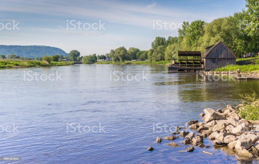 River Weser and old wooden mill near Minden, Germany stock photo