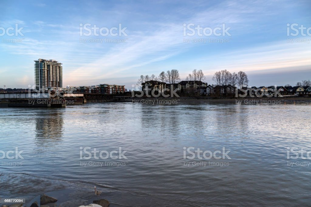 River with low tide at sunset stock photo