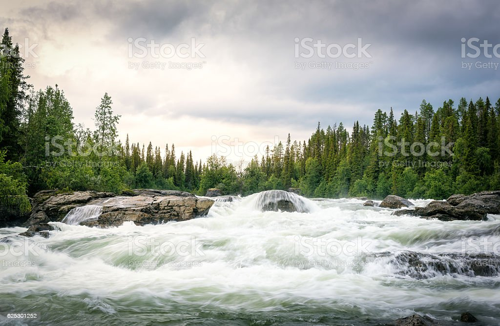 River With Strong Stream and Beautiful Sunset stock photo