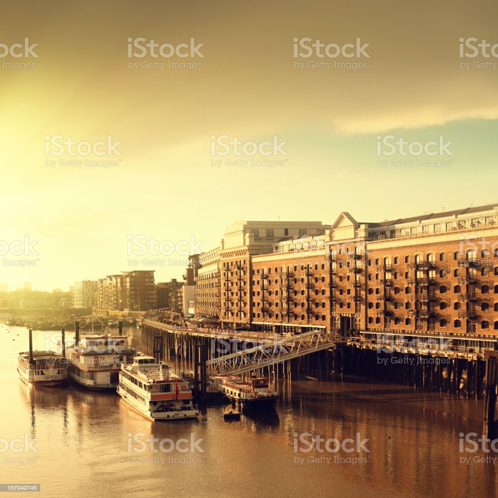 Riverbank and docks in London at dawn stock photo