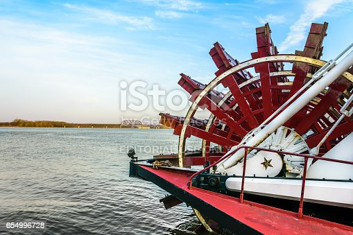istock Riverboat Paddlewheel on a wide river 654996728