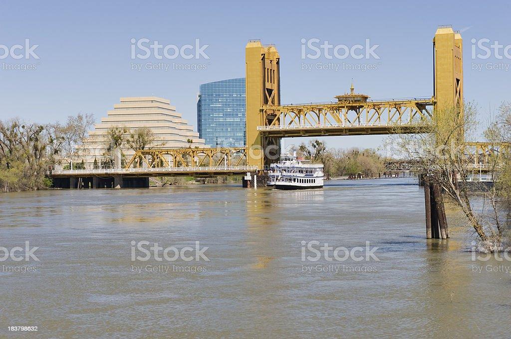 Riverboat under Bridge stock photo