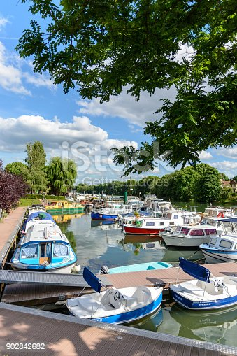 istock Riverboats, houseboats and electric rental boats mooring in the marina of Joinville-le-Pont in the inner suburbs of Paris. 902842682