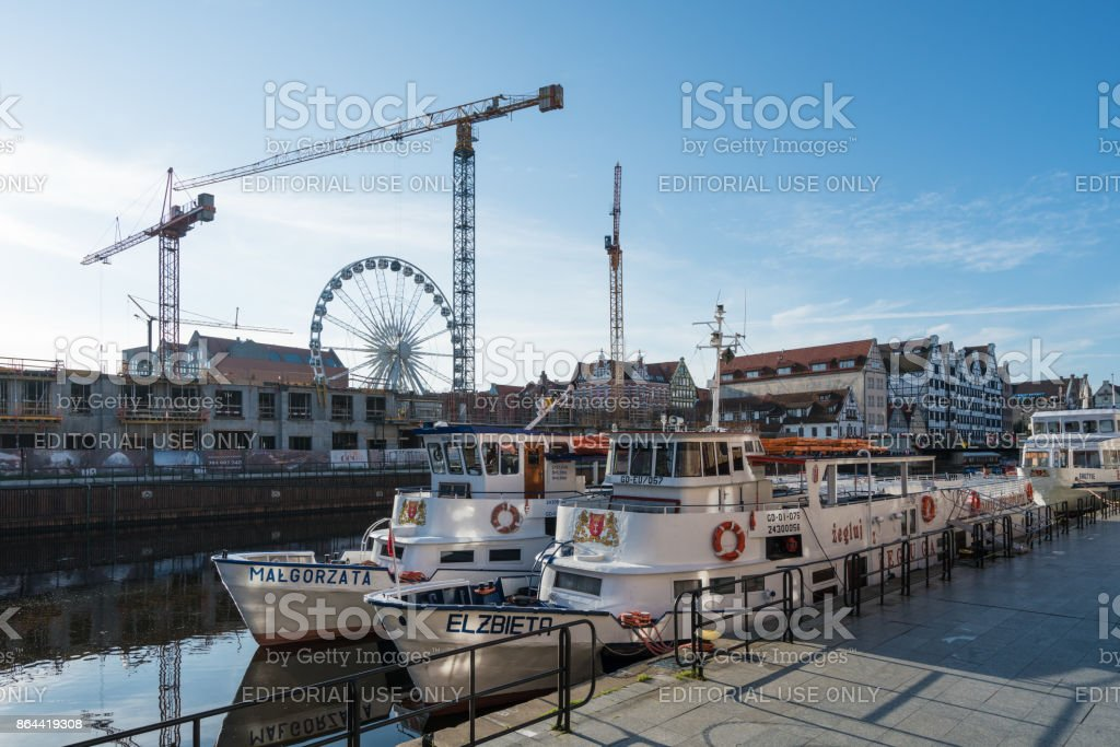 Riverfront cruise ships and boats in Gdansk stock photo