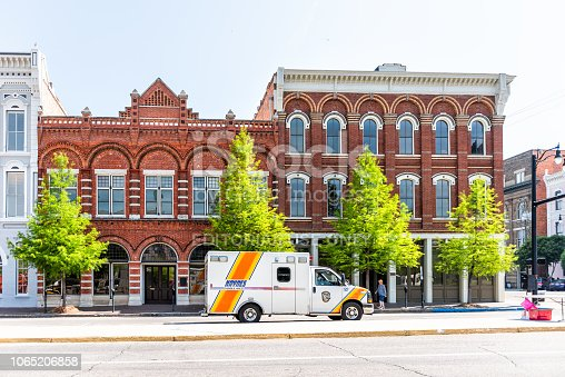 istock Riverfront park buildings on road street during day in capital Alabama city in downtown old town, ambulance 1065206858