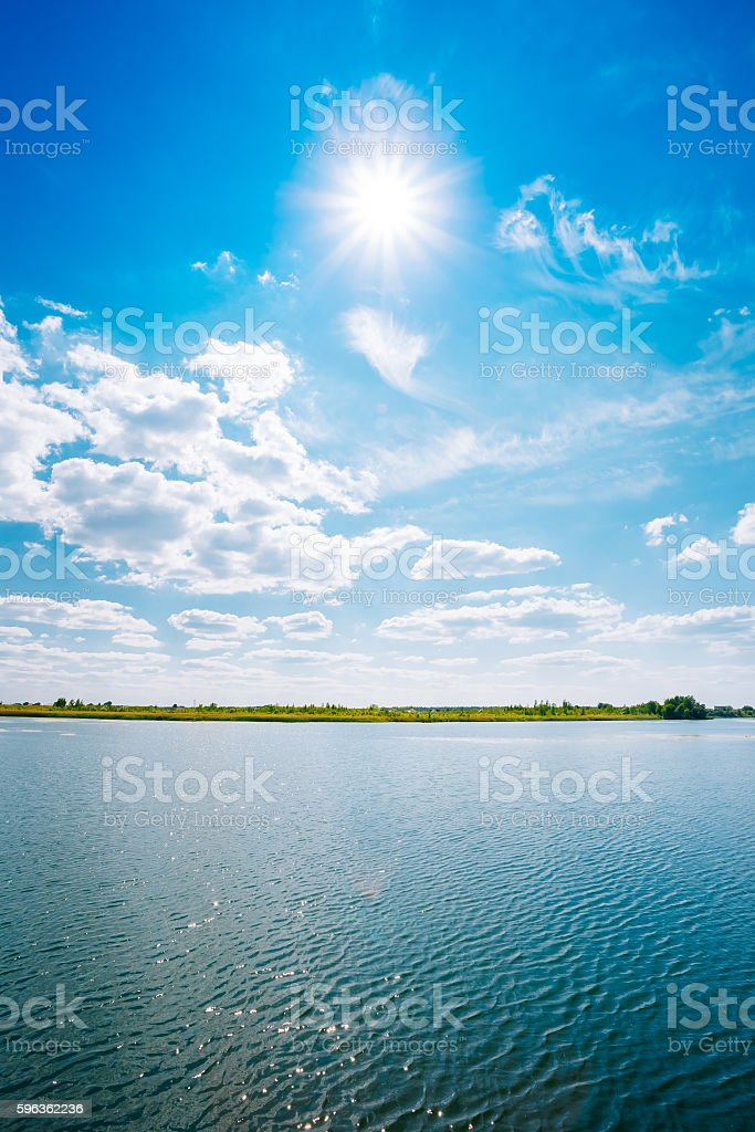 Riverine Skyline Landscape, River Lake Water Surface, Blue Clouds royalty-free stock photo