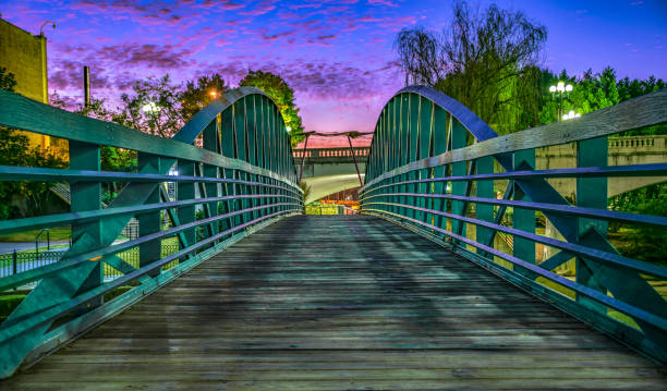 RiverPlace Bridge in Downtown Greenville South Carolina RiverPlace Bridge at sunrise on Main Street in Downtown Greenville South Carolina liberty bridge budapest stock pictures, royalty-free photos & images
