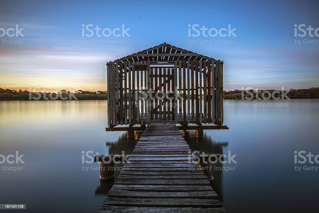riverside boathouse stock photo