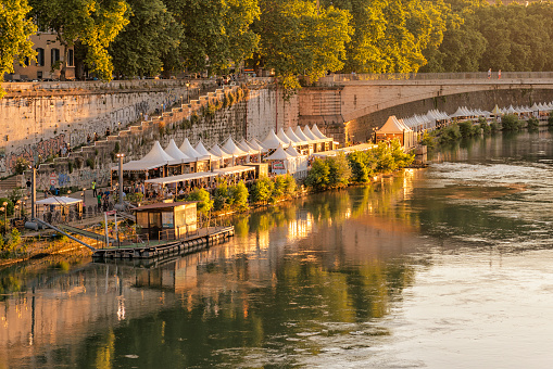 Riverside cafes over Tiber River in Rome
