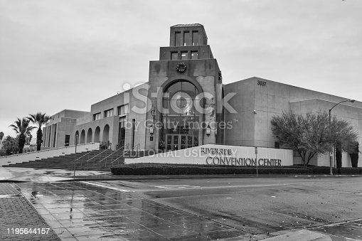Riverside, CA USA - December 23, 2019: Downtown Riverside, California with the historic Mission Inn, Convention Center and surrounding shops. Convention Center entrance on rainy day.