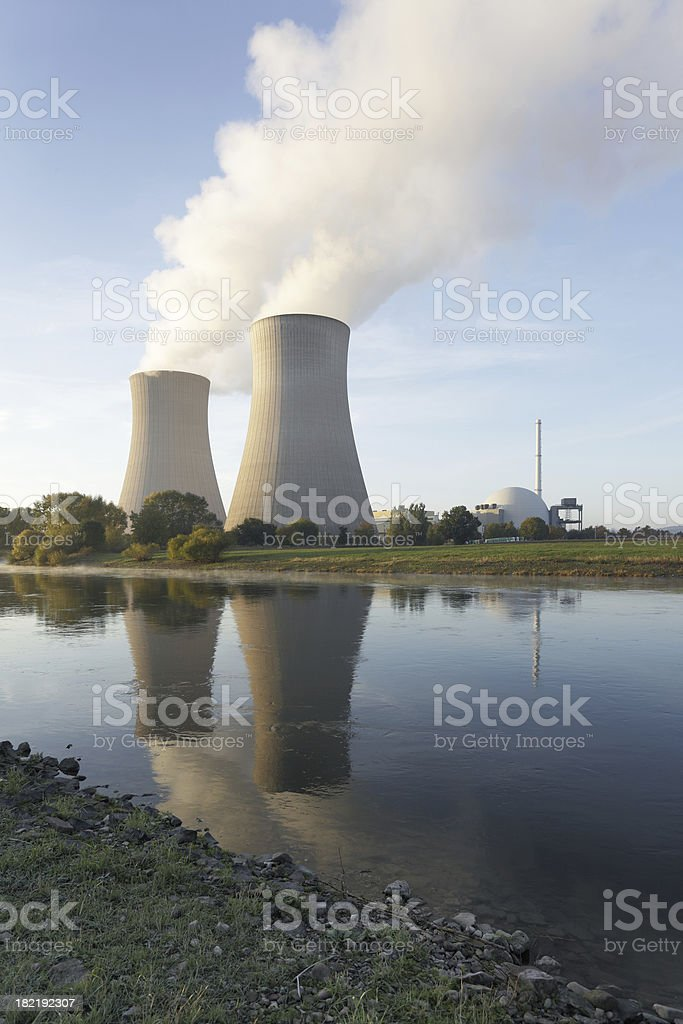 Riverside nuclear power station with steaming cooling towers (XXL) royalty-free stock photo