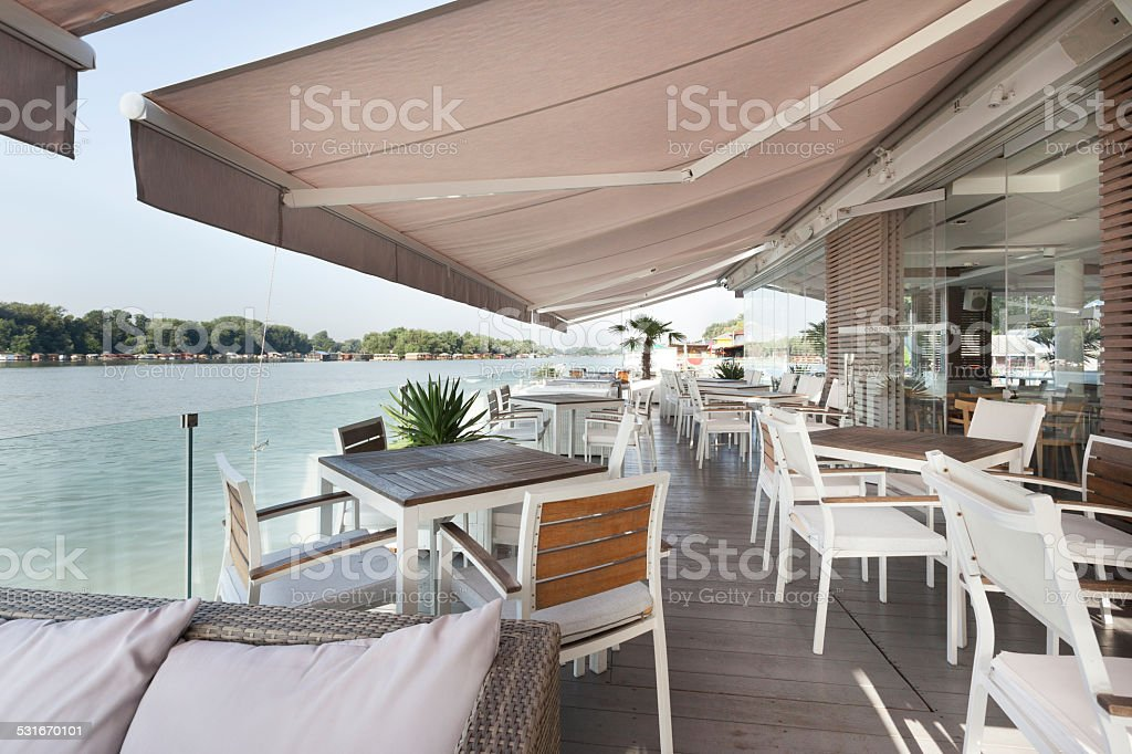 Riverside terrace cafe stock photo