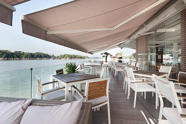 Riverside terrace cafe stock photo