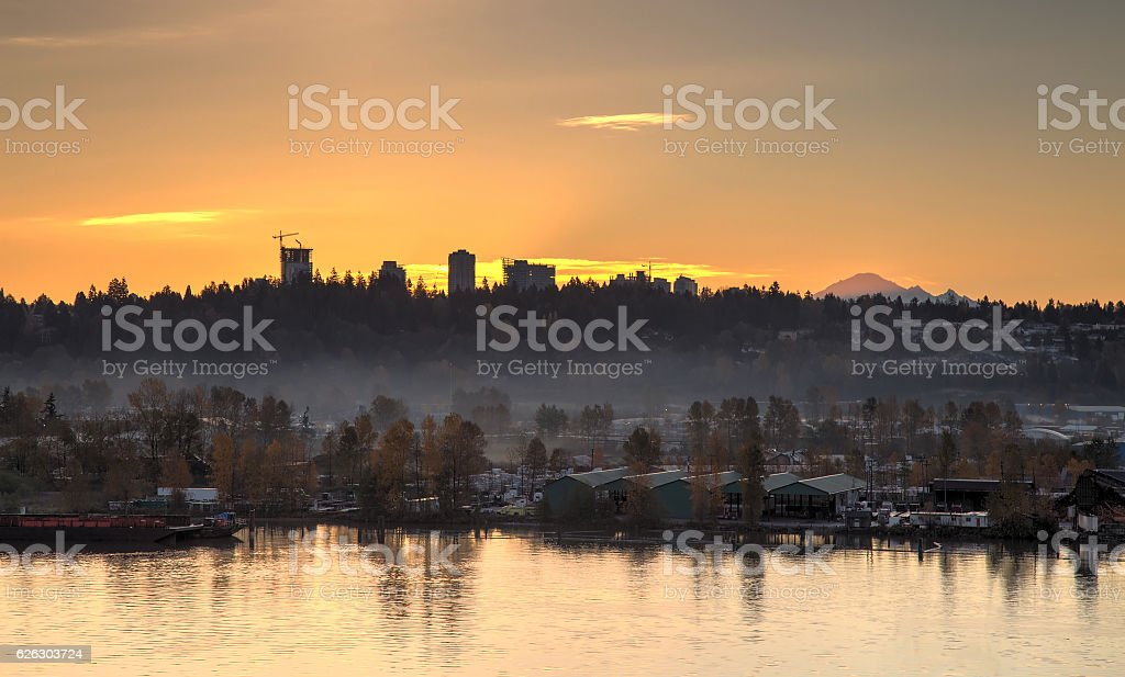 riverside with mist at sunrise stock photo