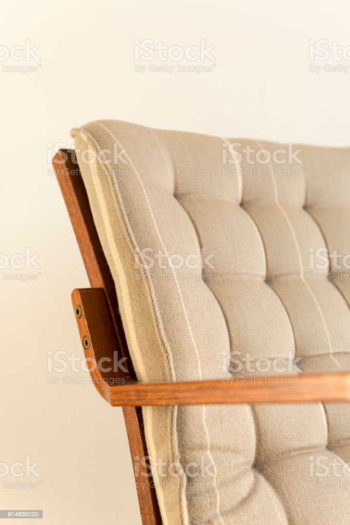 Riveted Backrest Cushion of Wooden Armchair on White Background stock photo