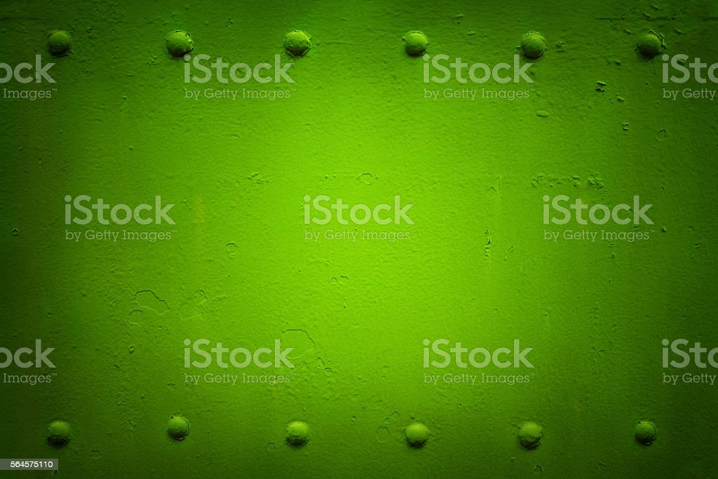 riveted metal plate 2 green stock photo