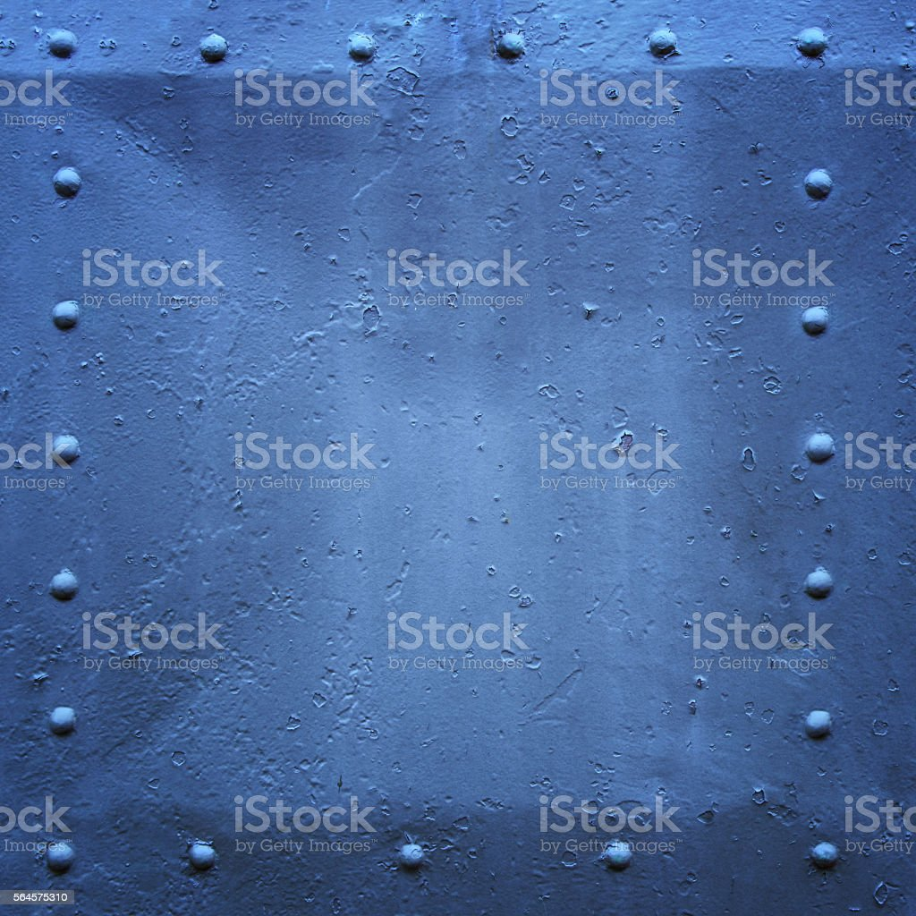 riveted metal plate blue square. stock photo