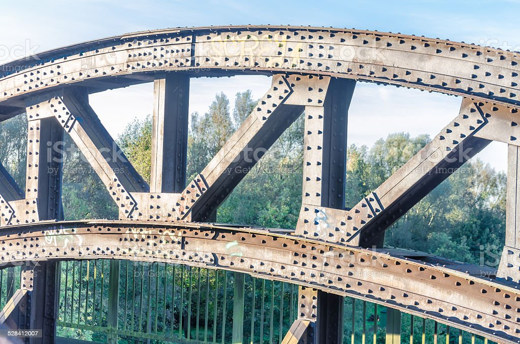 Riveted old bridge arch stock photo