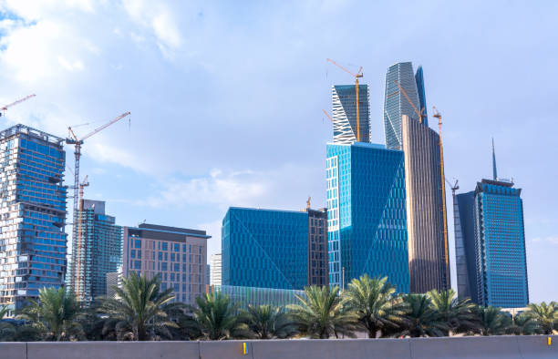 Riyadh, Saudi Arabia, KSA - September 22, 2018 new buildings being constructed in the new King Abdullah Financial District with train metro bridge in Riyadh stock photo