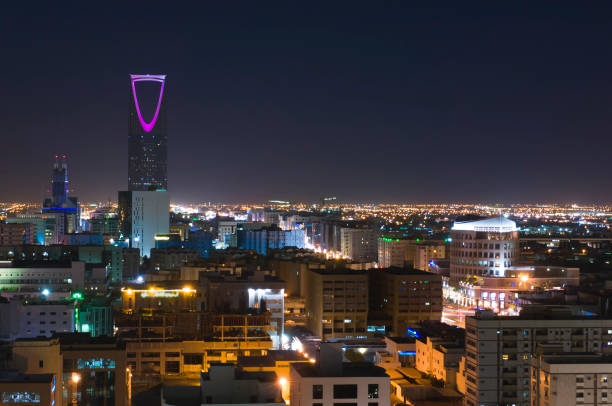 Riyadh Skyline at Night #11, with Kingdom Tower Lit in Purple, Saudi Arabia Riyadh Skyline at Night #11, with Kingdom Tower Lit in Purple, Saudi Arabia saudi arabia stock pictures, royalty-free photos & images