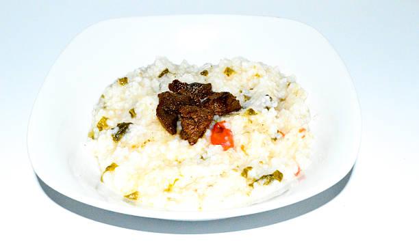 Riz aux herbes avec de la viande boucanée Riz aux herbes avec de la viande boucanée: cuisine malagasy. riz stock pictures, royalty-free photos & images
