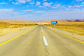 Negev, Israel - January 16, 2020: View of road 40, with a traffic safety sign, in the Negev desert, southern Israel