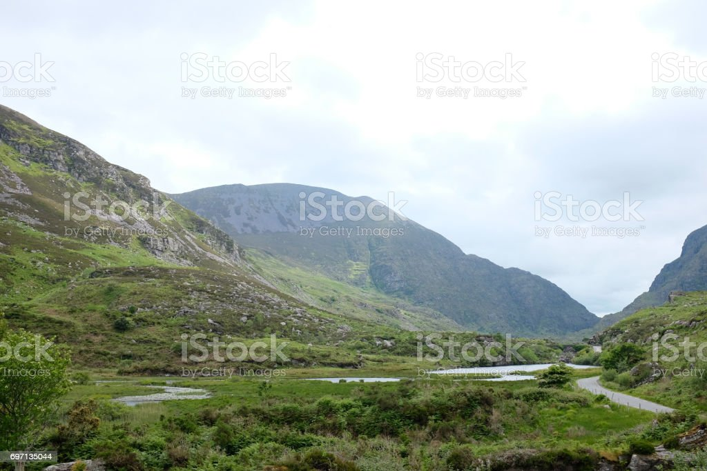 A road, a river and their mountains 2 stock photo