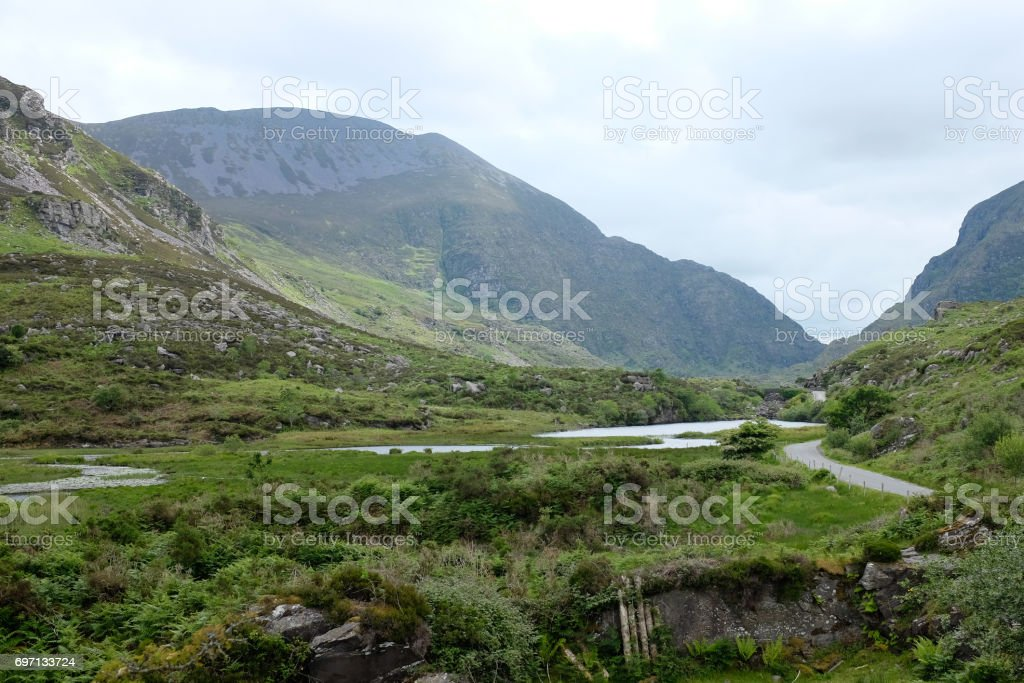 A road, a river and their mountains stock photo