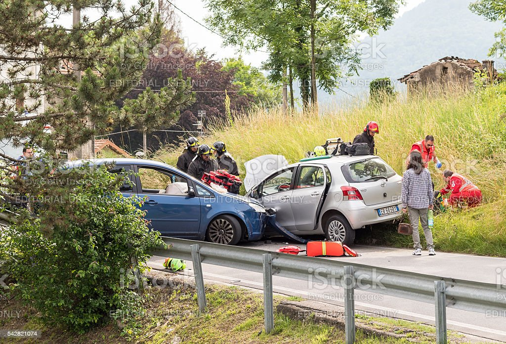 Road accident with rescue workers stock photo