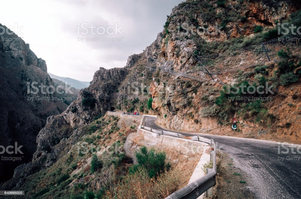 Road across the Topolia Gorge, canyon in Crete, Greece stock photo