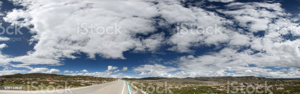 Road  against blue sky in Tibet stock photo